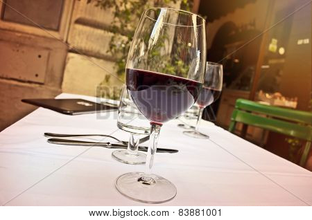 Glass Of Red Wine At Outdoor Restaurant