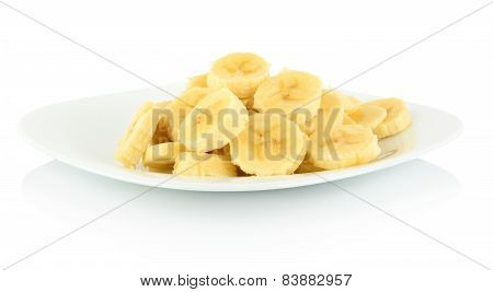 Macro Shot Of Slices Of Banana On Plate On White