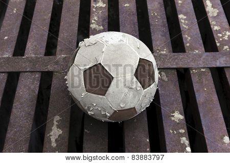 Old Football Ball On Rust Iron Bar