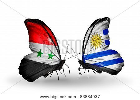 Two Butterflies With Flags On Wings As Symbol Of Relations Syria And Uruguay