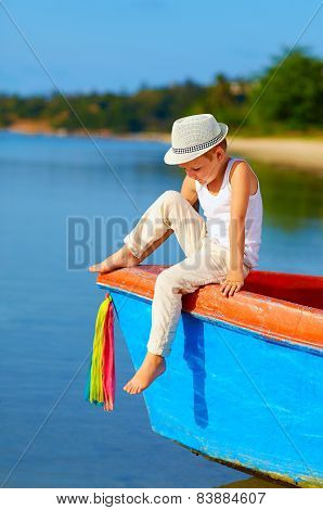 Cute Kid, Boy Sitting On The Bow Of A Boat