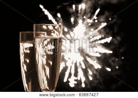 Two Champagne Glasses At Night Fireworks