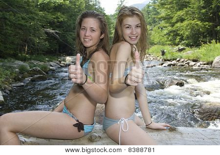 Attractive Teen Girls Playing in Water