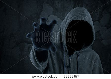 Burglar With Hoody Grabbing Something