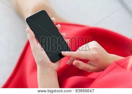 Girl In Red Dress Holding A Black Phone