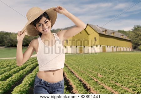 Happy Woman Standing At Farmland