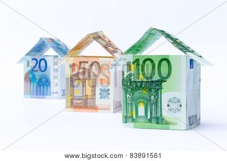 Three houses made of euro notes