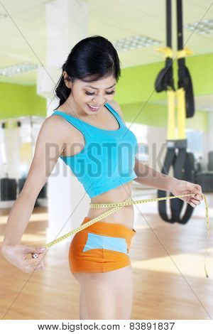 Healthy Woman Measuring Her Waistline