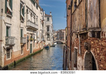 Venetian Canal Rio De La Pleto With Small Bridge. Old Walls With Balcony And Architecturical Element