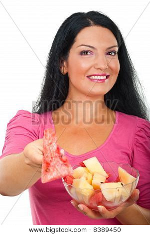 Cheerful Woman Giving Water Melon In Fork