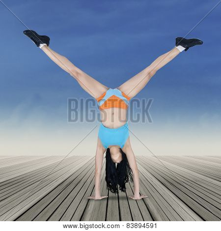 Woman Doing Handstand Exercise