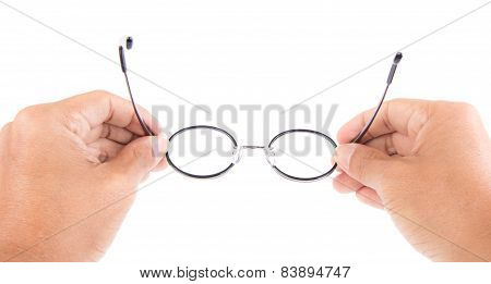Reading Glasses In Hand