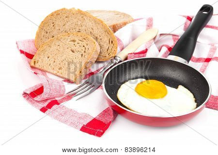 Fried Egg In A Frying Pan, Over White Background