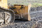 stock photo of excavator  - closeup of tracked loader excavator at stony quarry on a building site - JPG