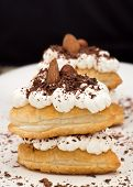 stock photo of nack  - Puff pastry with cream and chocolate - JPG
