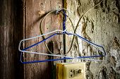 pic of clothes hanger  - Close up of old clothes hangers - JPG