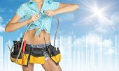 picture of framing a building  - Woman in tool belt with different tools - JPG