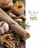 stock photo of whole-wheat  - Whole wheat italian pasta with garlic and herbs - JPG