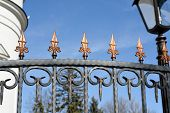 foto of stiletto  - Decorative metal forged fence with ornaments in old stiletto - JPG
