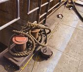 image of bollard  - photo of a bollard with rope in a harbour - JPG