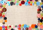 pic of sewing  - Copyspace image with multicolored sewing buttons on linen - JPG