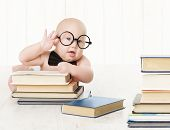stock photo of child development  - Baby in Glasses and Books Kids Early Childhood Education and Development Smart Child Preschool Reading Concept over White Background - JPG