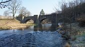 foto of old bridge  - Old stone bridge over the river Freiberger Mulde in the Erzgebirge in Middle Saxony - JPG