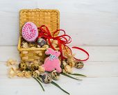 picture of quail egg  - Biscuits Easter Bunny and egg in a basket of quail egg on wooden background - JPG