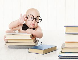 image of child development  - Baby in Glasses and Books Kids Early Childhood Education and Development Smart Child Preschool Reading Concept over White Background - JPG