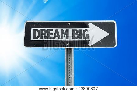 Dream Big direction sign with a beautiful day