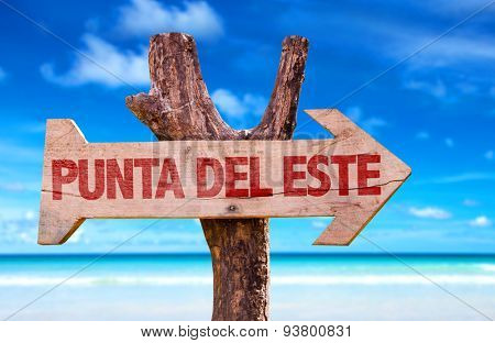 Punta Del Este wooden sign with beach background