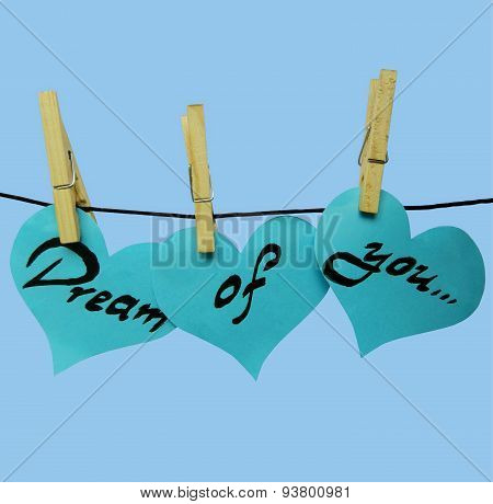 Blue paper hearts on clothespins with inscription - Dream of you