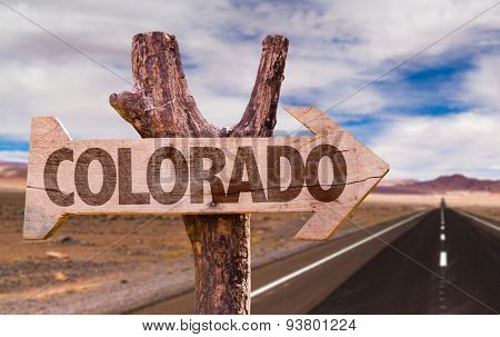 Colorado wooden sign with desert road background