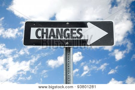 Changes direction sign with sky background