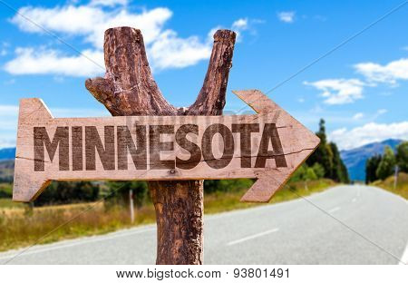 Minnesota wooden sign with road background