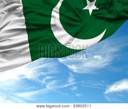 Pakistani waving flag on a beautiful day