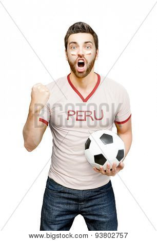 Peruvian fan holding a soccer ball celebrates on white background