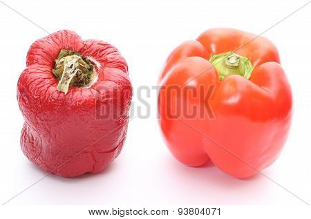 Fresh And Wrinkled Peppers On White Background