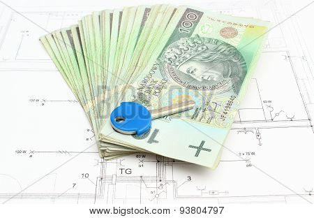 Stack Of Money With Key Lying On The Housing Plan