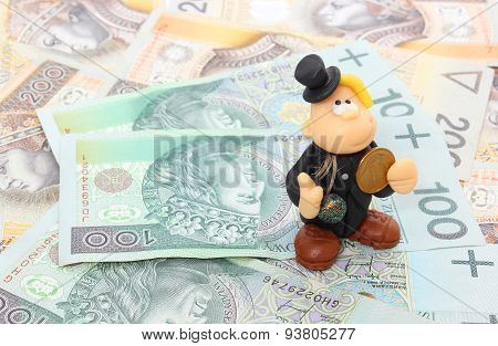 Chimney Sweep With Coin On A Stack Of Money. Isolated On White