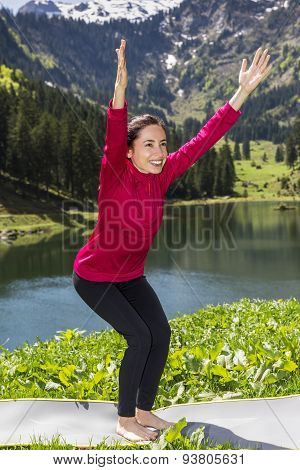Woman Doing Chair Pose Outdoors