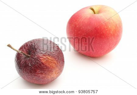 Fresh And Wrinkled Apples On White Background