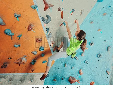Beautiful Woman Climbing In Gym