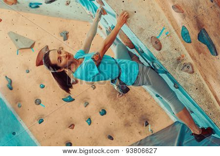 Beautiful Girl Climbing In Gym