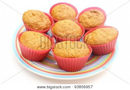 Fresh Baked Carrot Muffins In Red Silicone Cups