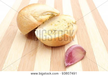 Fresh Baguette With Garlic Butter On Wooden Cutting Board
