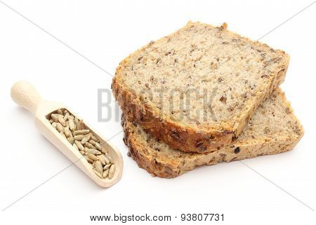 Natural Rye Grain On Wooden Spoons And Pieces Of Bread