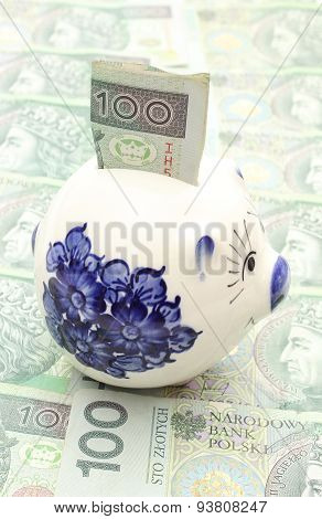 Piggy Bank And Money On Heap Of Banknotes