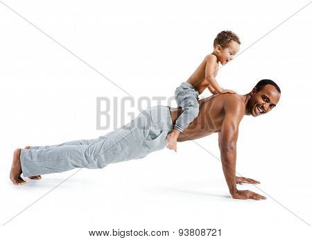 Muscle Man Making Push Ups With His Son Sitting On His Back