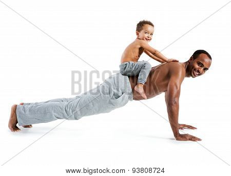 Son Sitting On His Father's Back